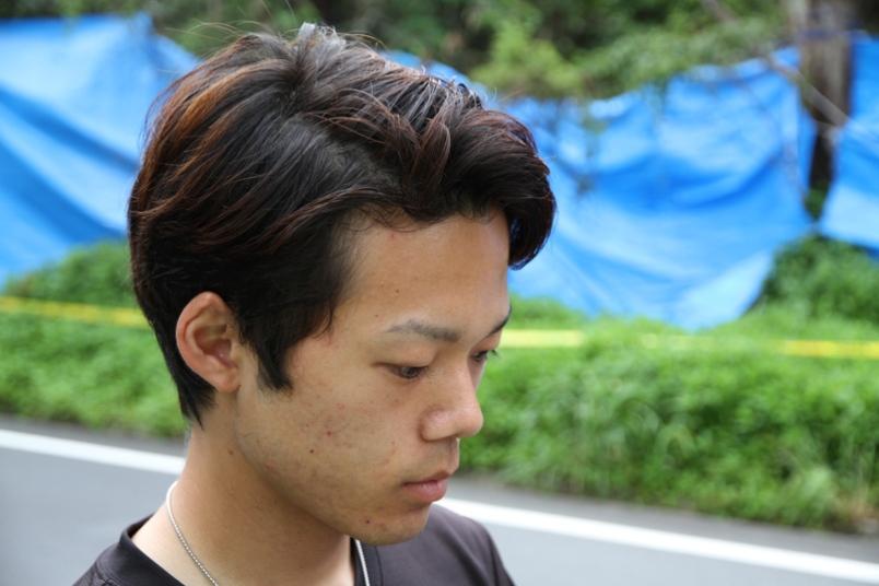 Kakeru Miyagi praying for the soul of his former classmate, Rina Shimabukuro  Source